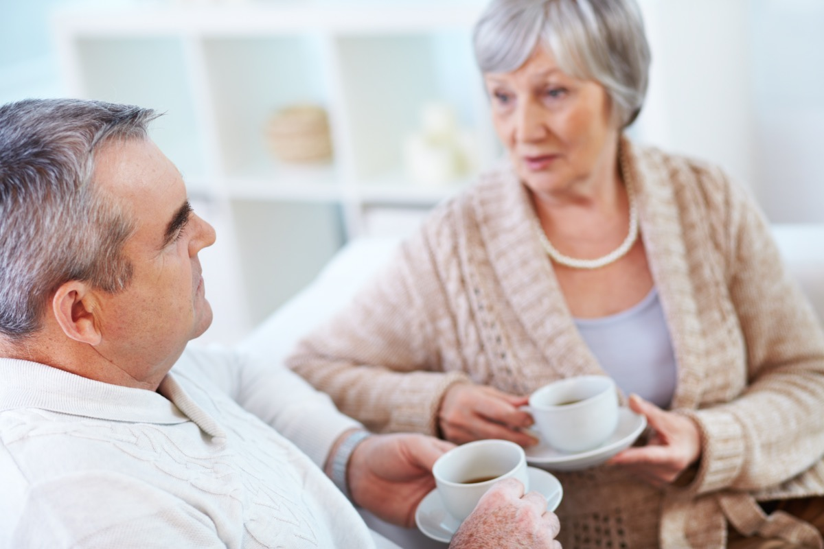 Senior man and woman talking over coffee