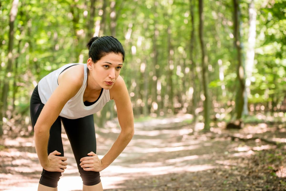 Tired female runner outside