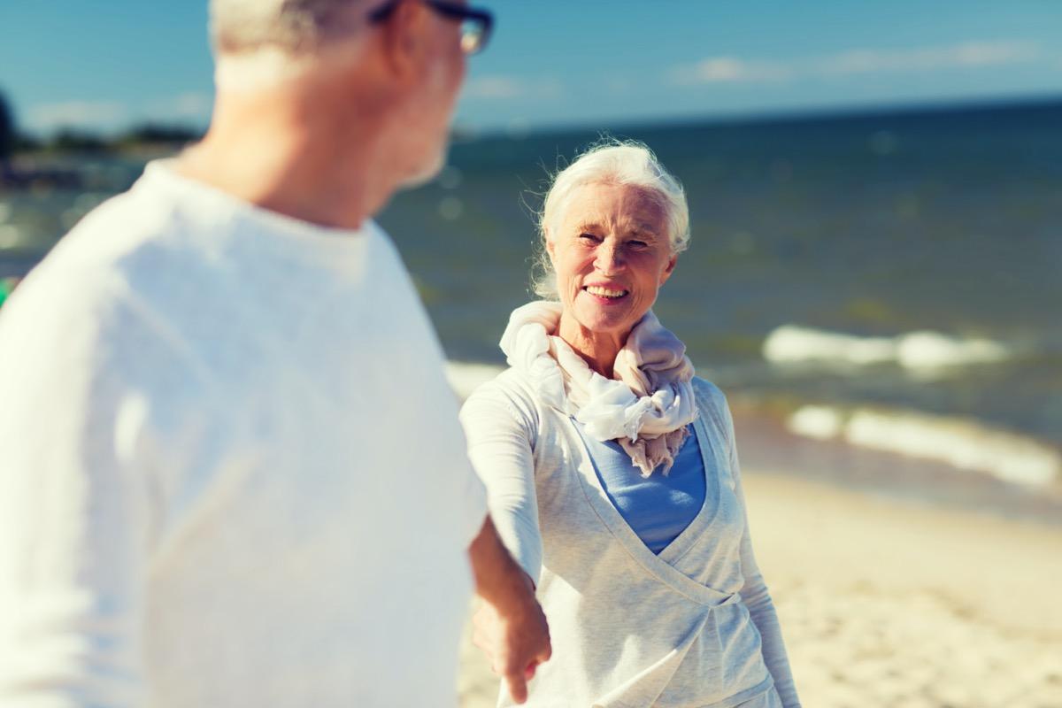 White senior man and woman on beach