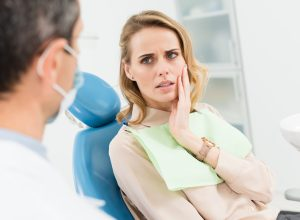Woman at dentist with pain in her jaw
