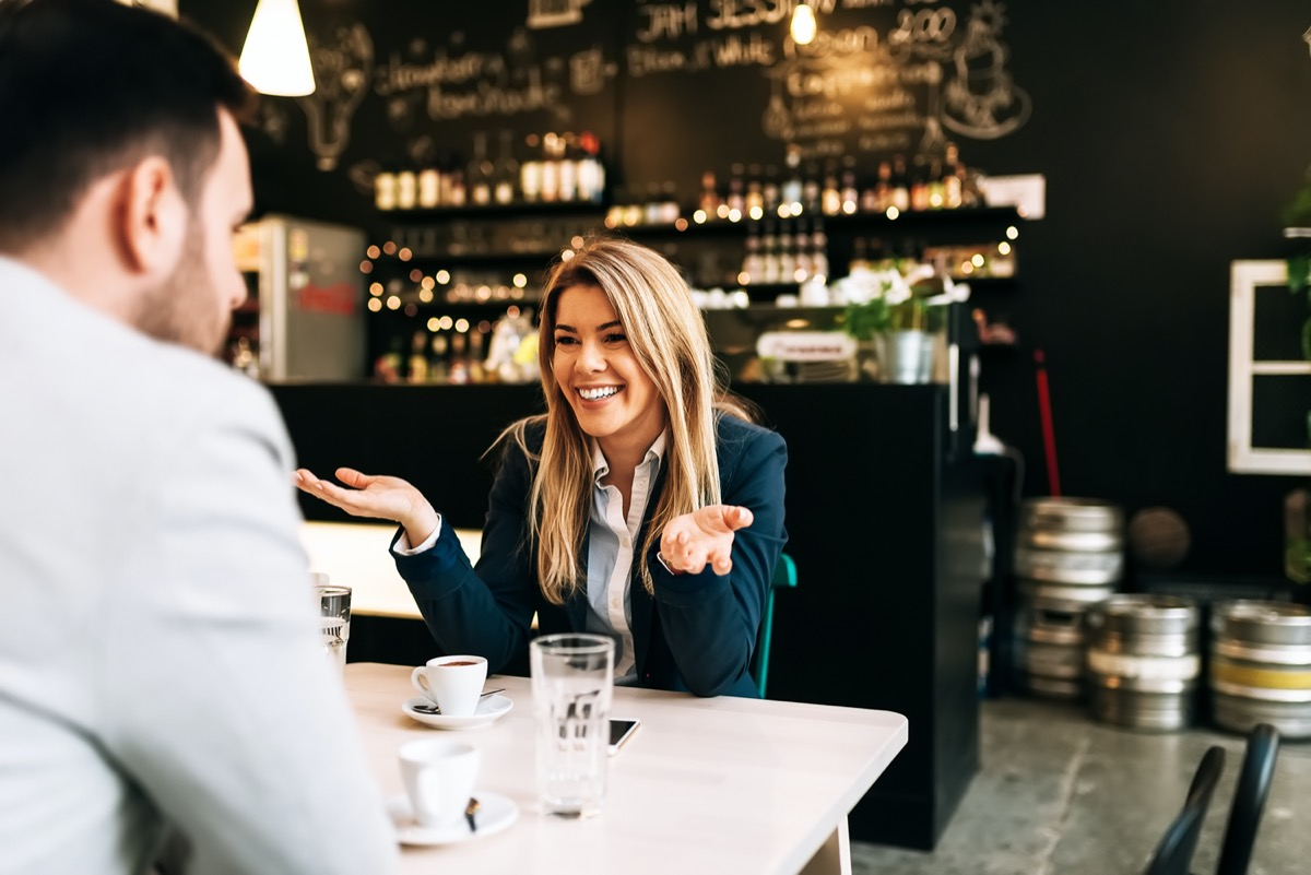 Young man and woman on first date in bar