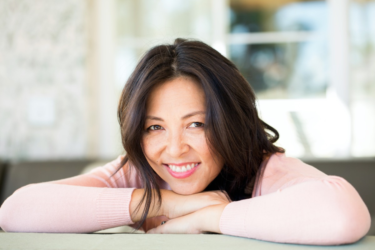 middle aged asian woman with long hair