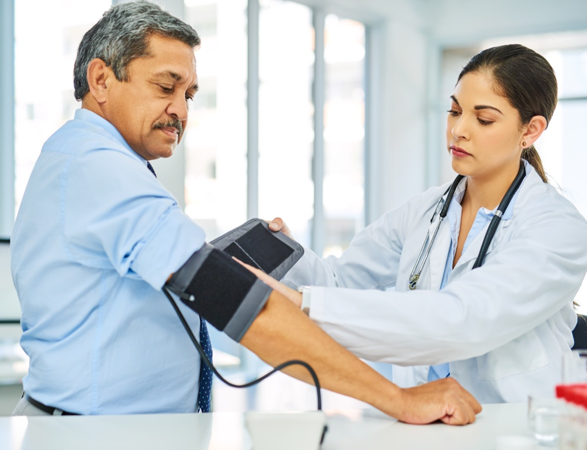 Shot of a doctor checking a patient's blood pressure in a hospital