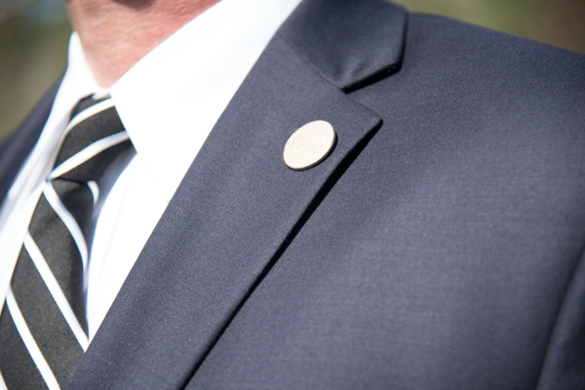 man wearing black tie and blue suit