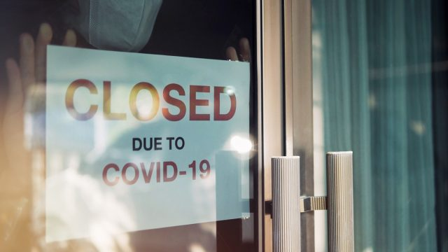Store with closed due to COVID sign
