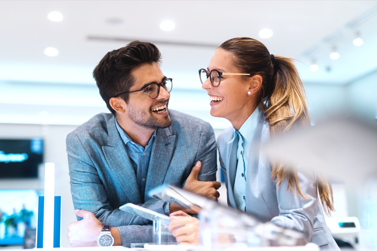 Confident man and woman laughing