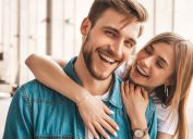 Confident man and woman smiling