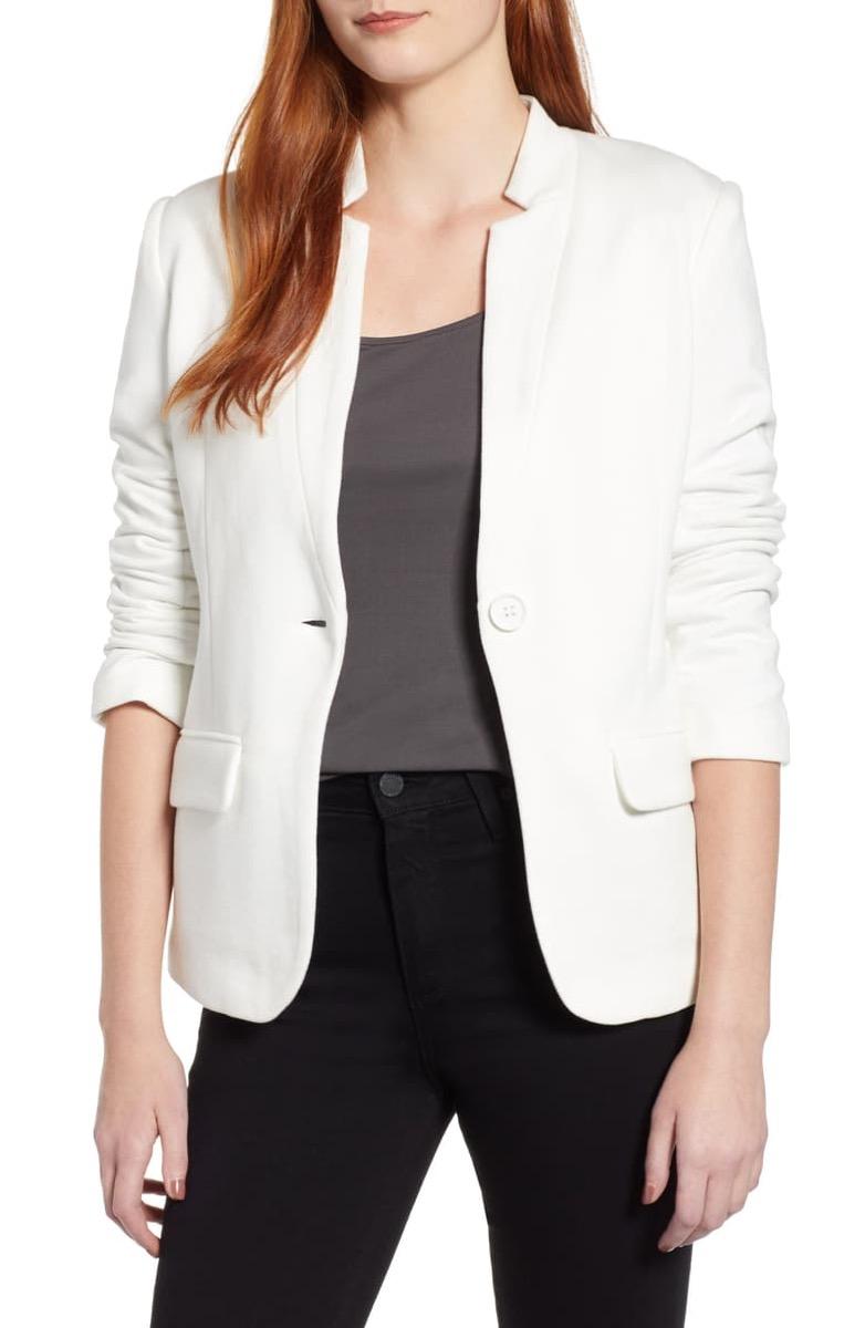 white redhead woman in white blazer