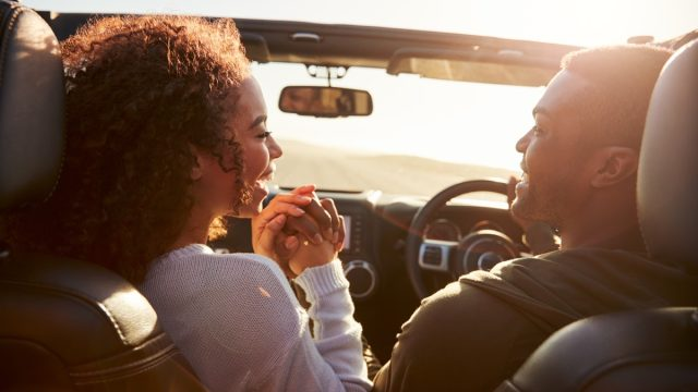 Couple in love driving in the car