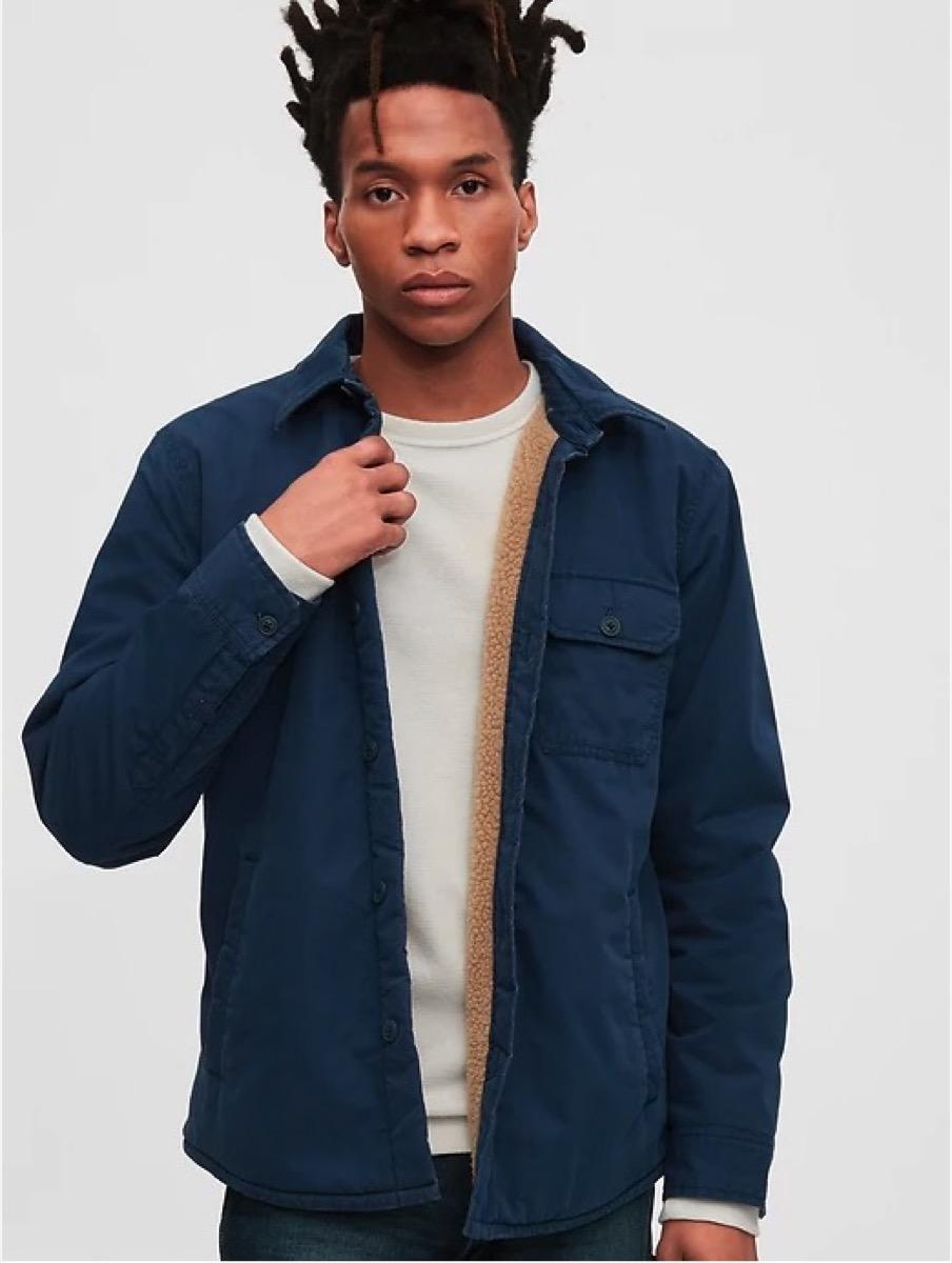 young black man in men's shirt jacket