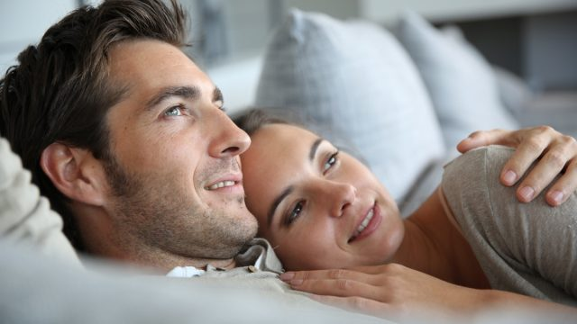 woman resting her hed on husband
