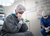 Worried healthcare coworkers at operating room in hospital