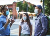Friends walking together during virus epidemic