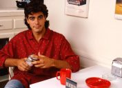 Portrait of George Clooney in a diner, Los Angeles, USA., in the 1980s, holding a sugar shaker