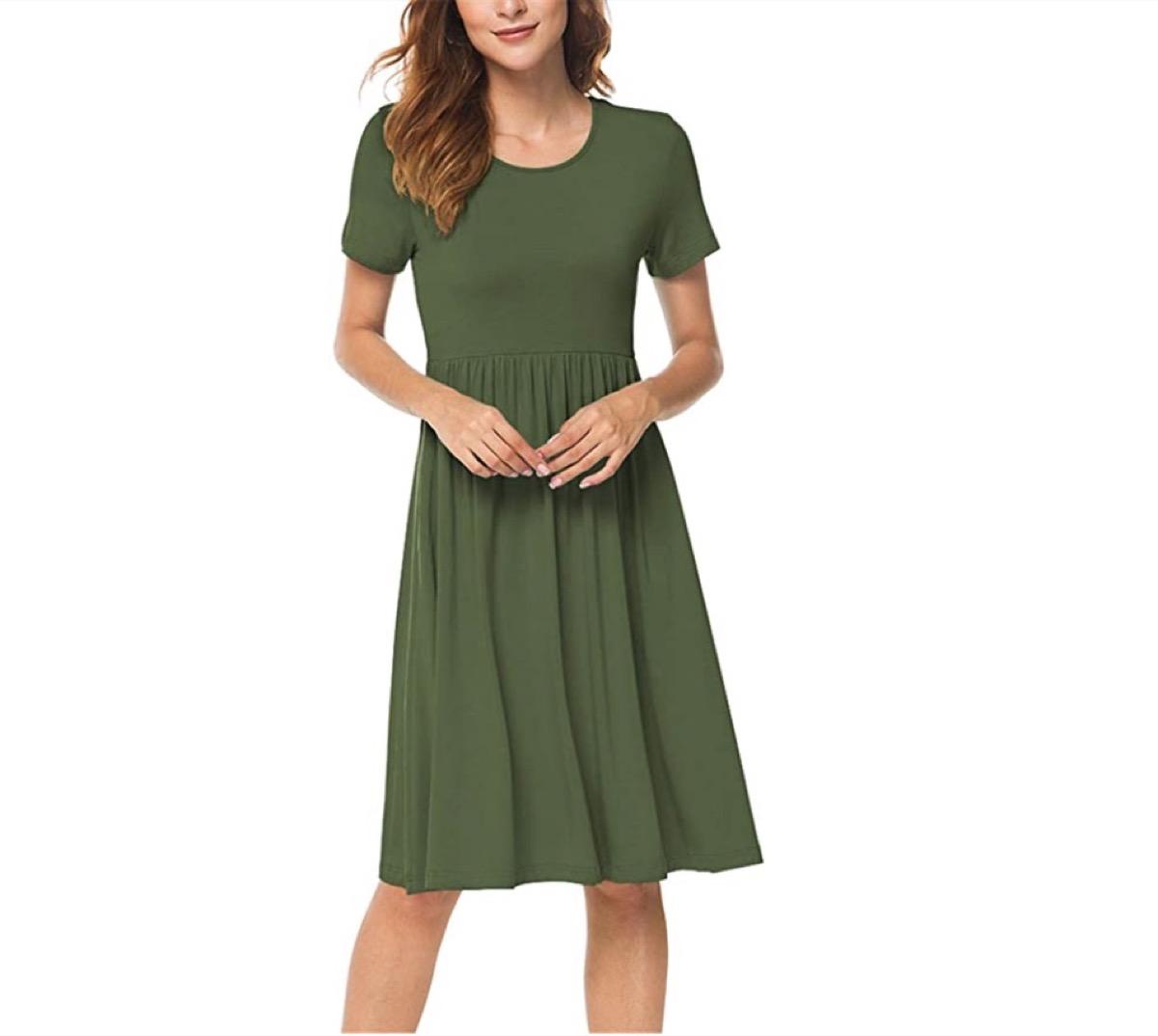 white woman in green dress