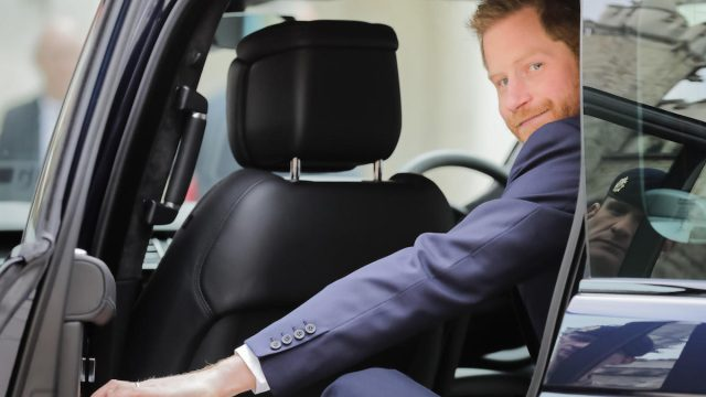 Prince Harry, The Duke of Sussex closes the car door as he leaves the twelfth annual Lord Mayor's Big Curry Lunch in aid of the three National Service Charities