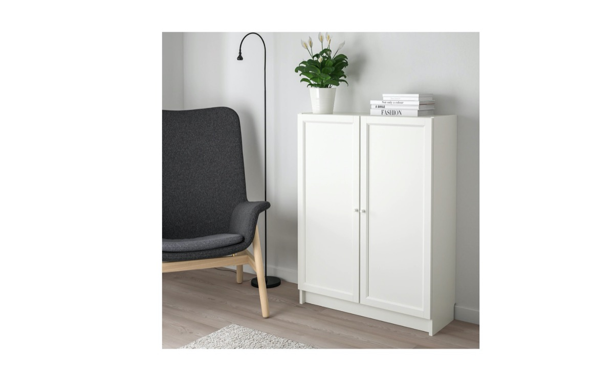 ikea billy bookcase in modern room next to gray chair