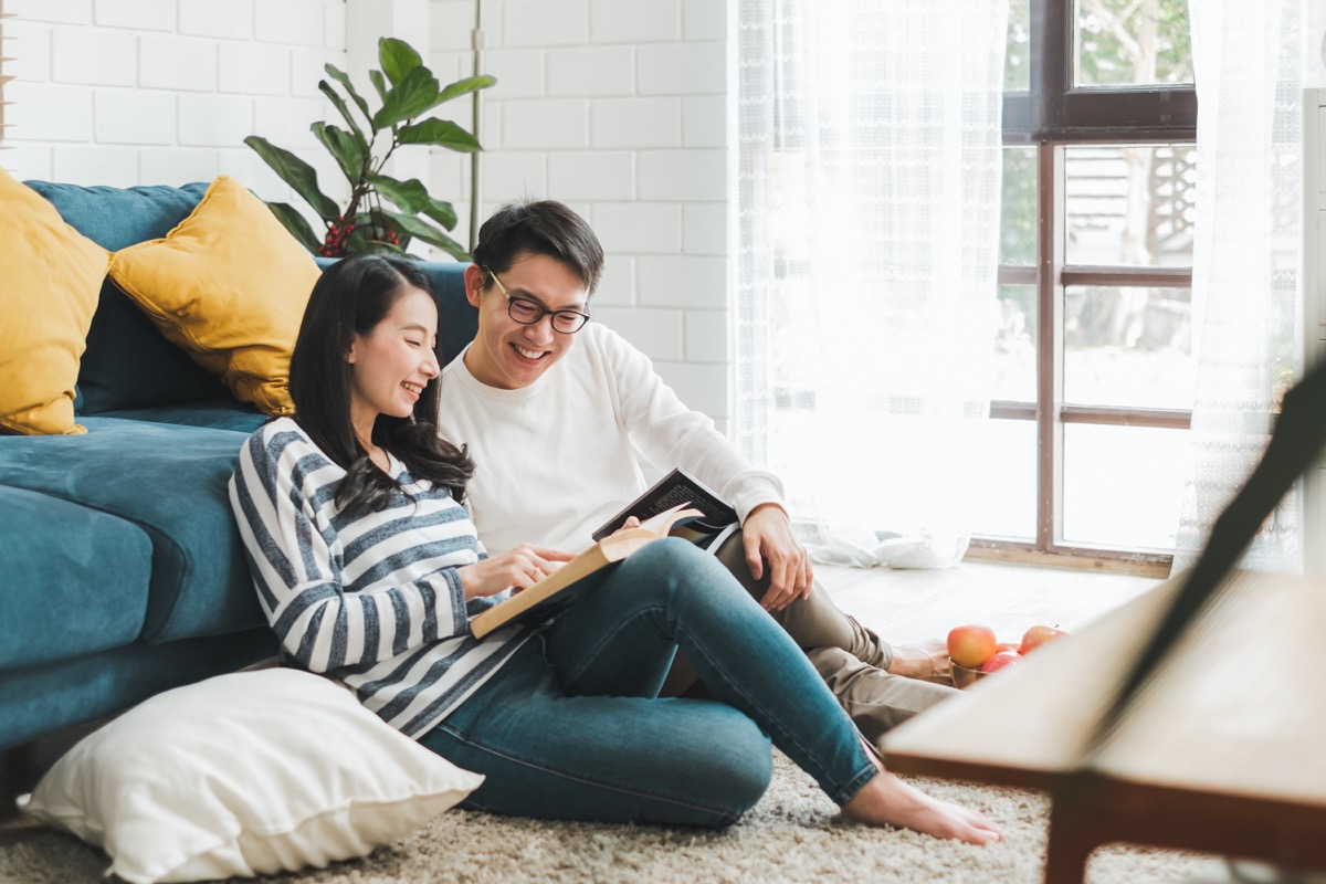 Intelligent couple reading together