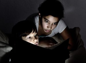 kids reading a ghost story