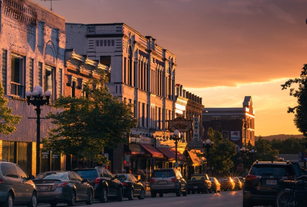 An image of historic Pearl Street in downtown La Crosse, Wisconsin at sunset during the summer.