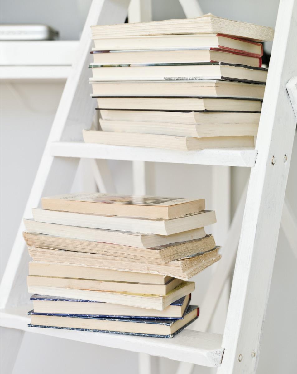 books on white ladder