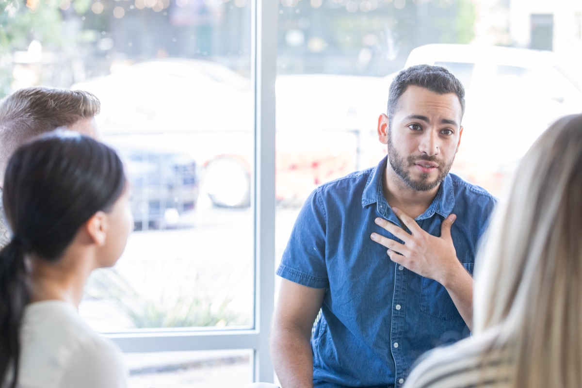 Man talking during a support group meeting