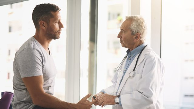 Cropped shot of a senior doctor giving his male patient a thorough checkup during his consultation