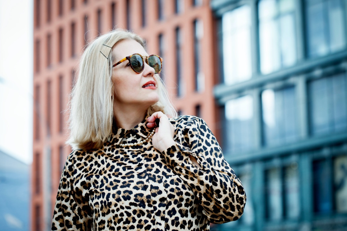 white middle aged woman wearing leopard dress