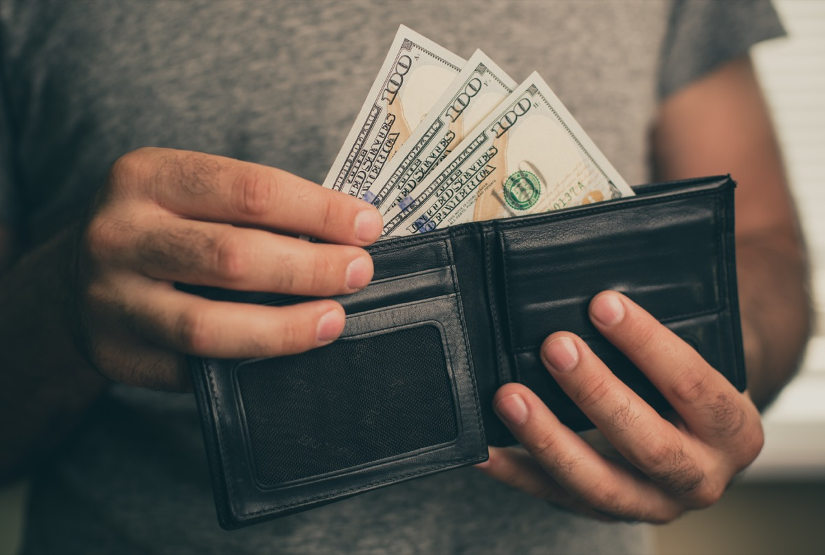 Man taking money out of his wallet