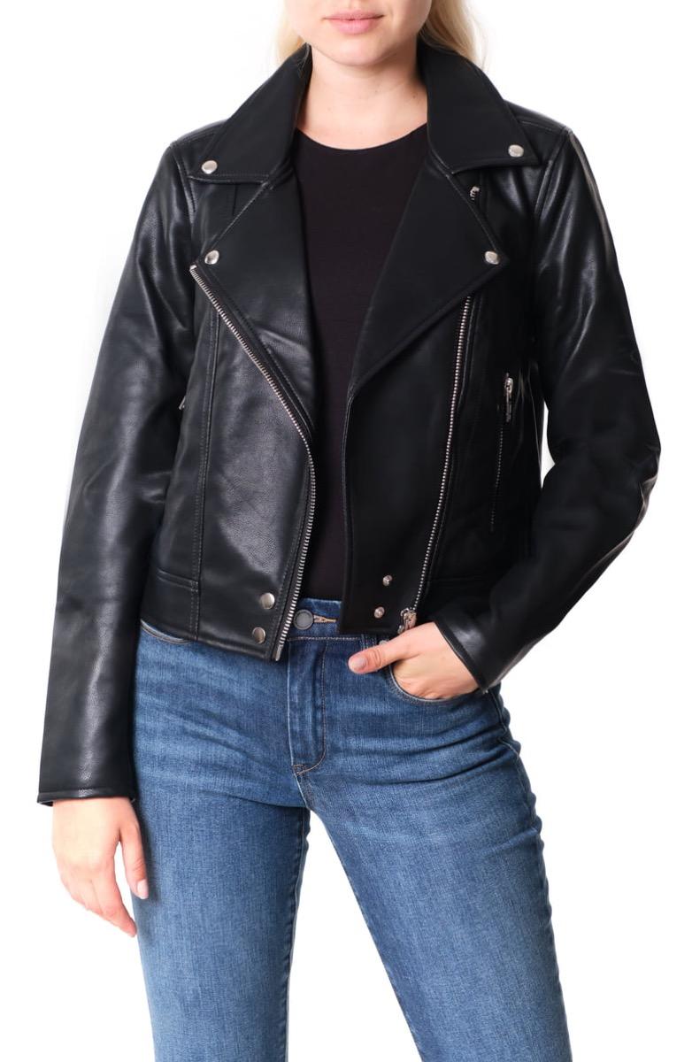 white woman in black leather moto jacket
