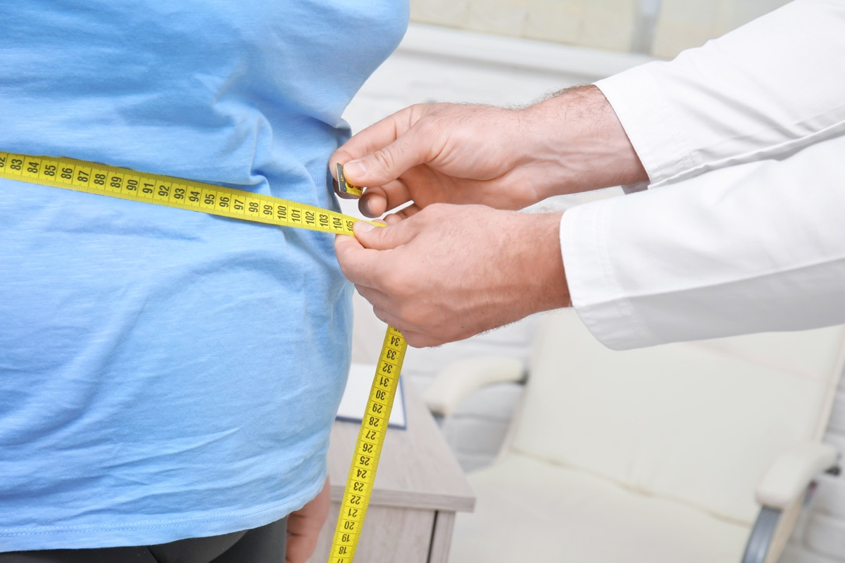 Person with obesity being measured