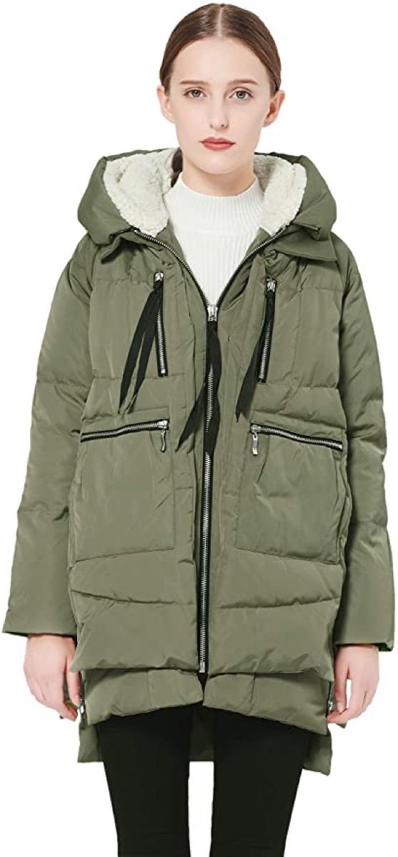 white woman in green puffer coat