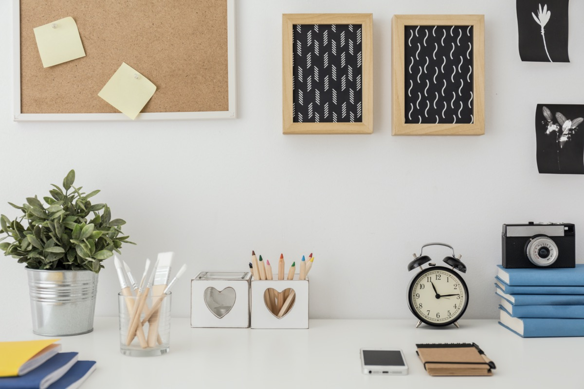 modern home office with two corkboard picture frames