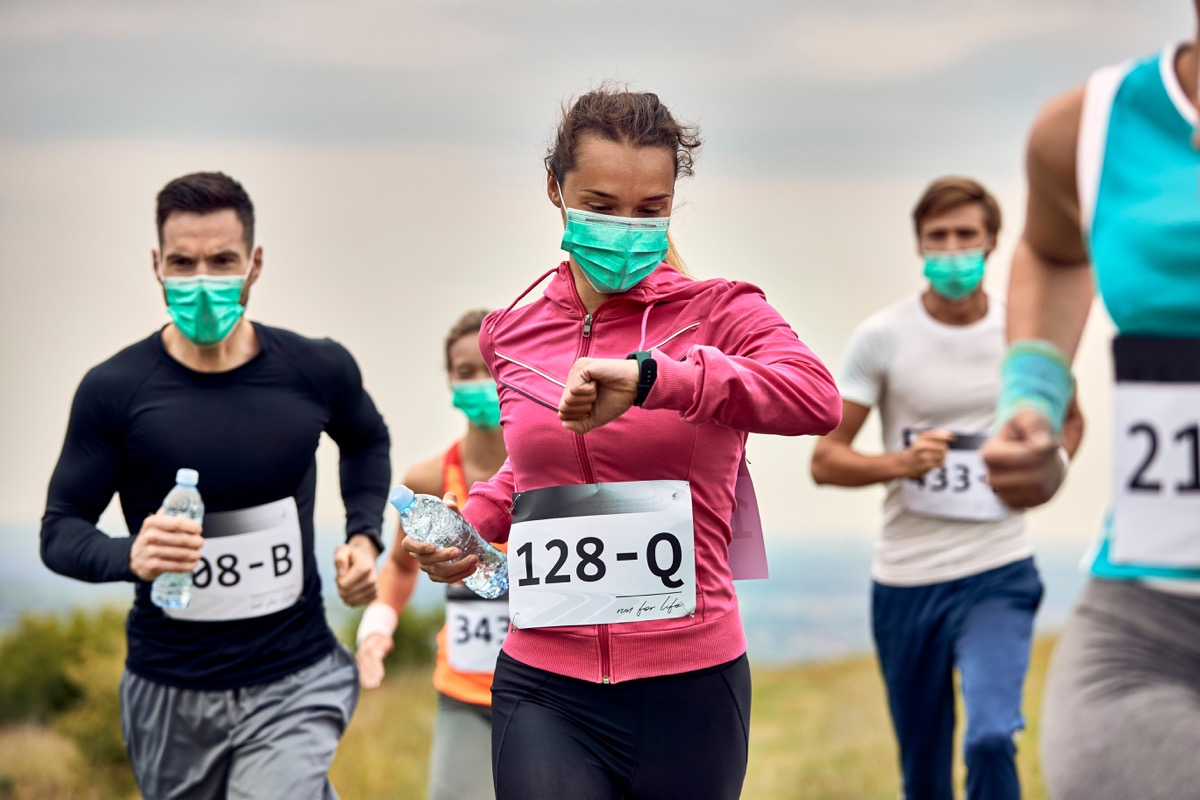 People running a race wearing face masks
