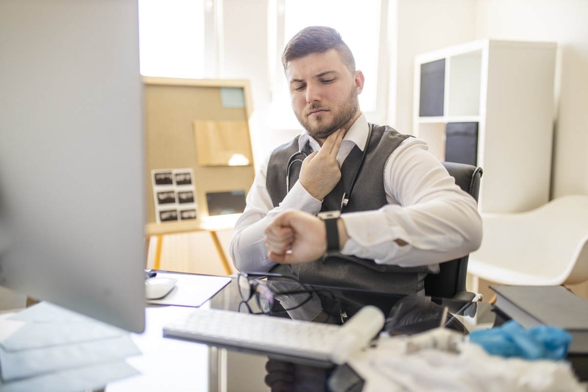 Doctor taking a pulse at office