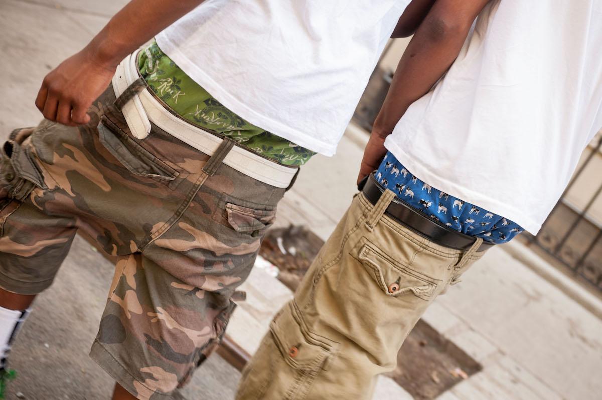 Two gentlemen in Harlem in New York show off their sartorial splendor by baggie pants showing their underwear