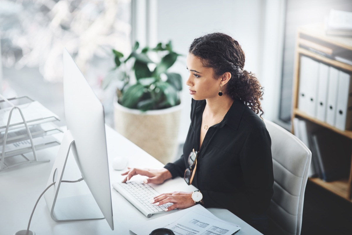 Shot of a young businesswoman working on a computer in an office