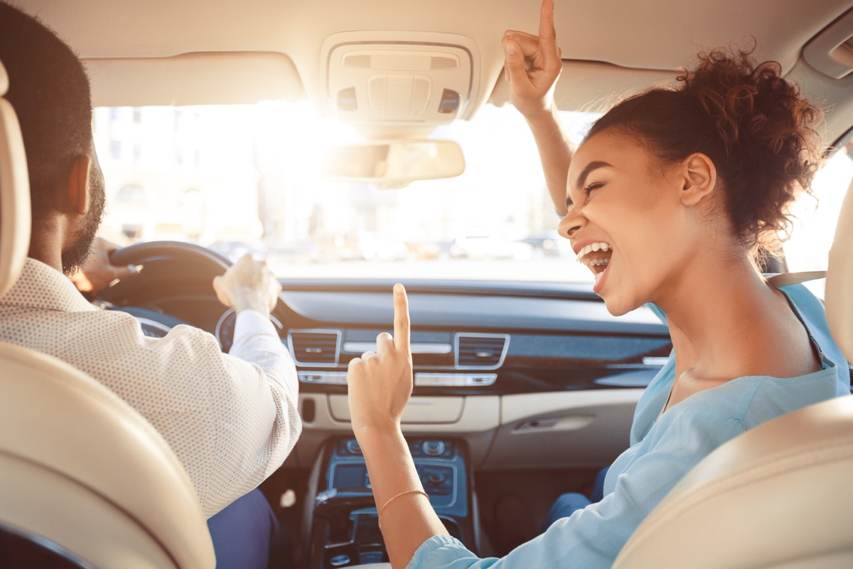 Woman singing in the car