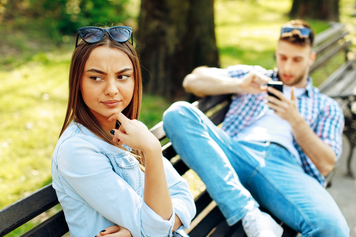 Man using his phone in the middle of a date