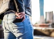 Man putting his wallet in his back pocket