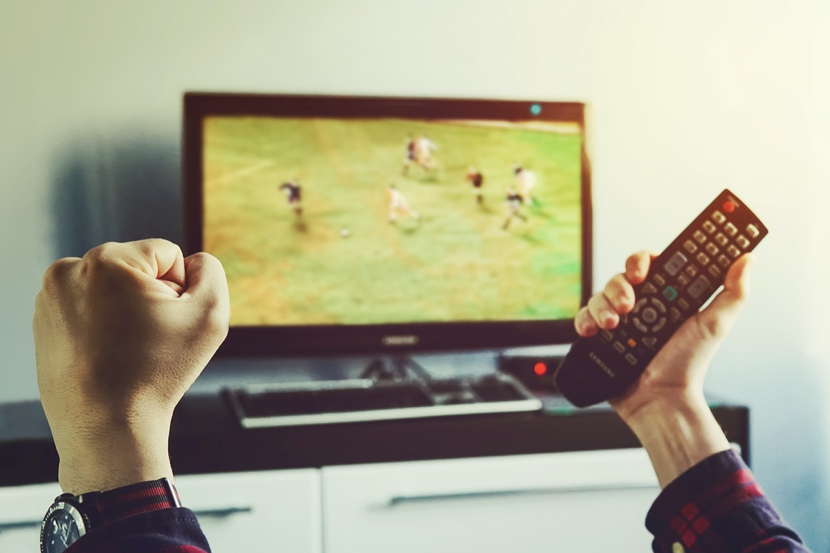 white guy watching soccer on tv