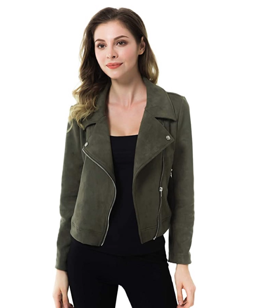 young white woman in green cropped jacket