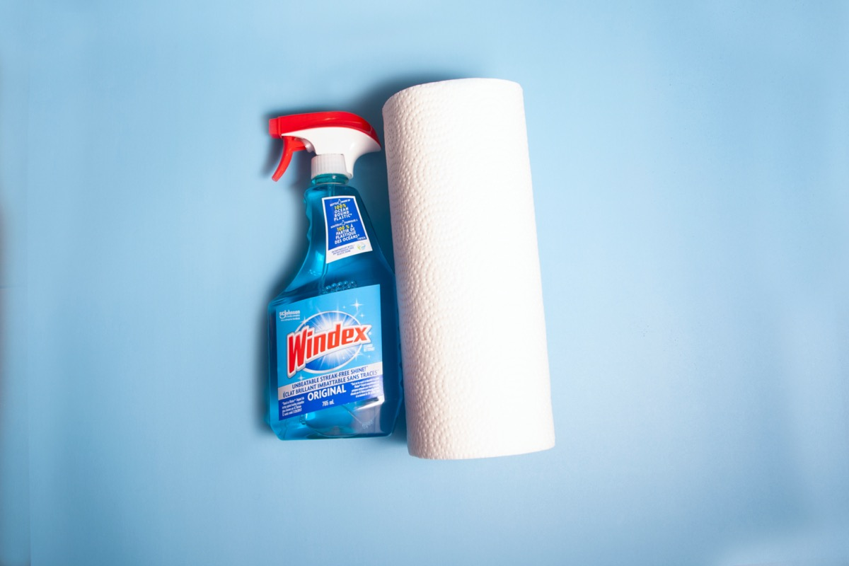 bottle of windex and roll of paper towels
