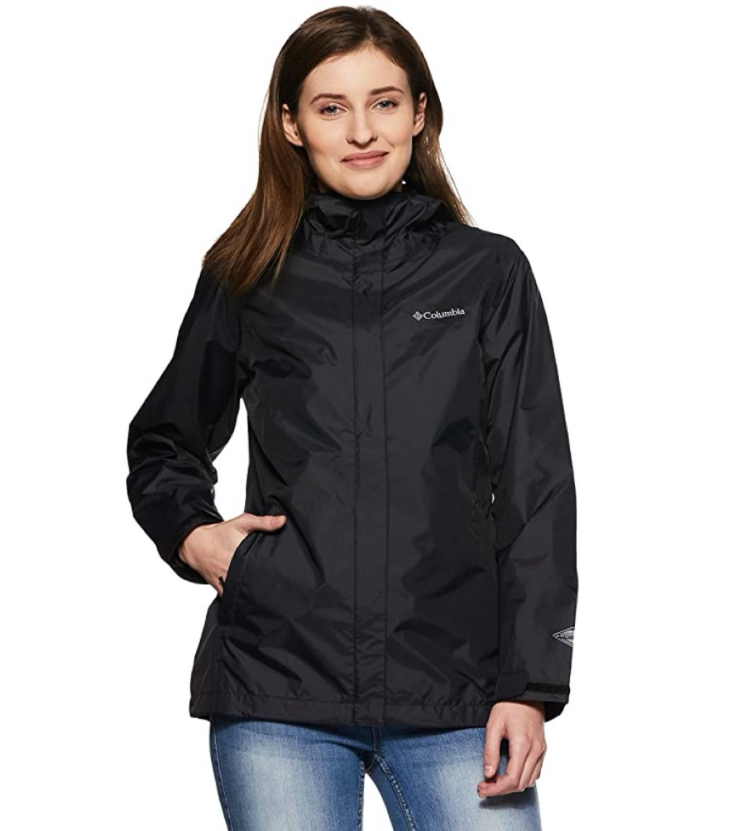 young white woman in black rain jacket