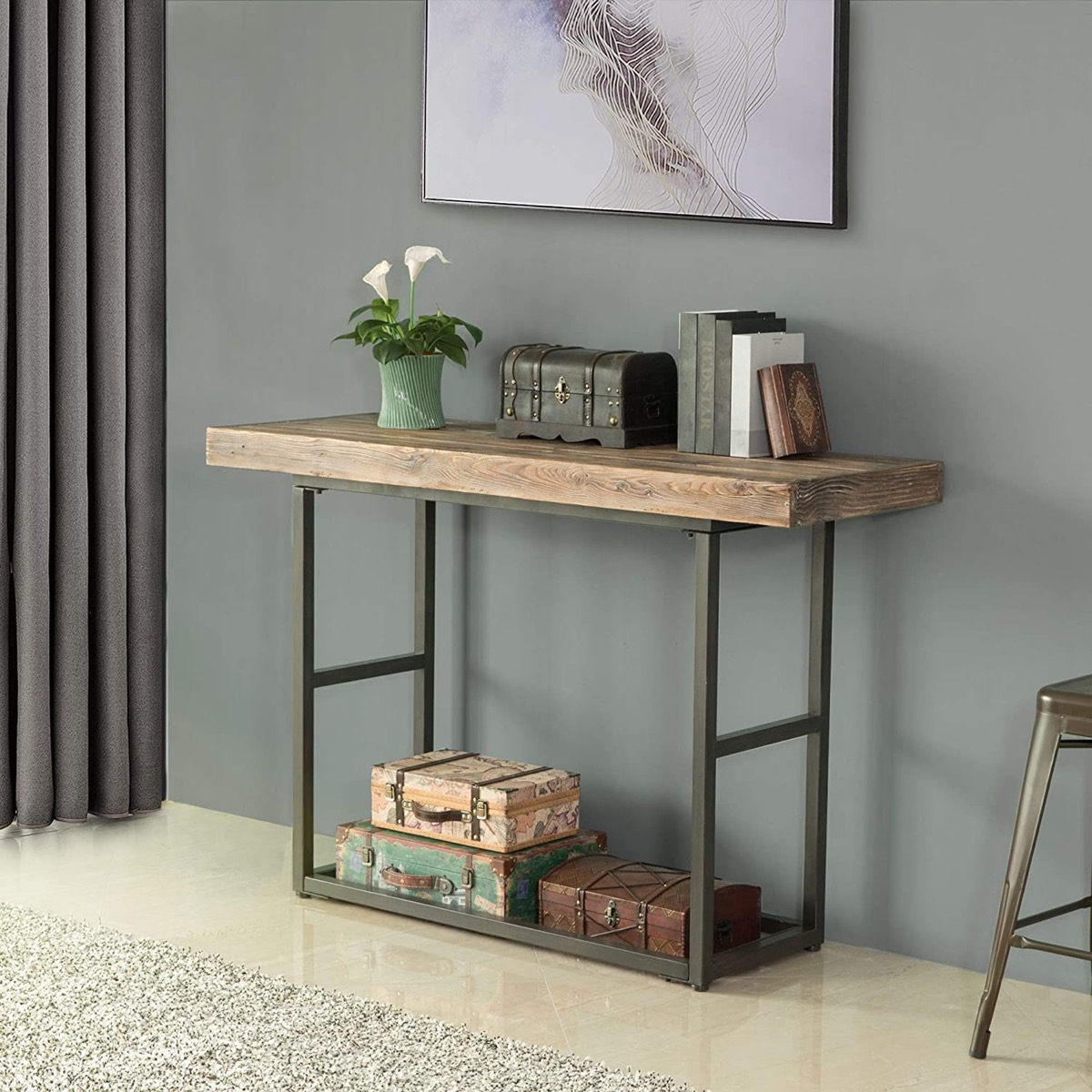 rustic farmhouse table with accessories on top against green wall