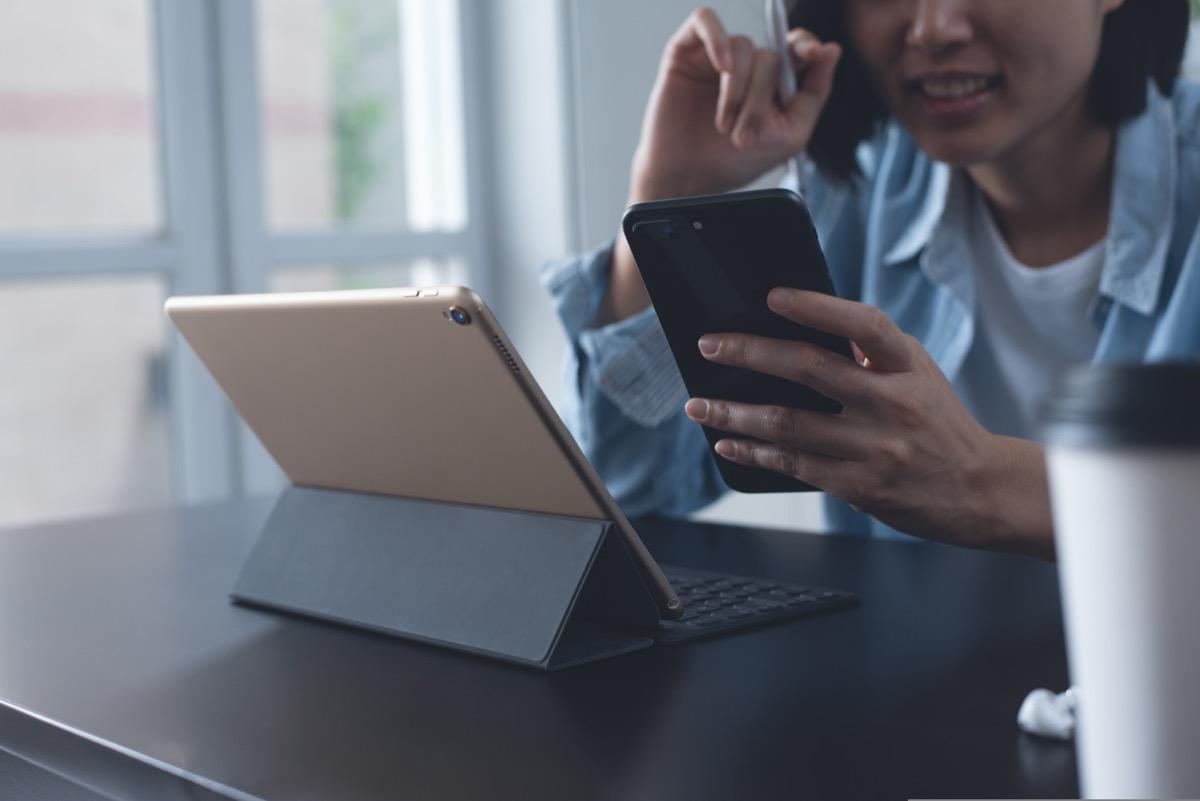 Woman on both ipad and phone