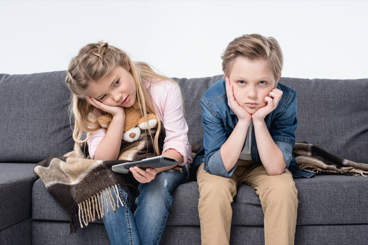 Bored kids on couch