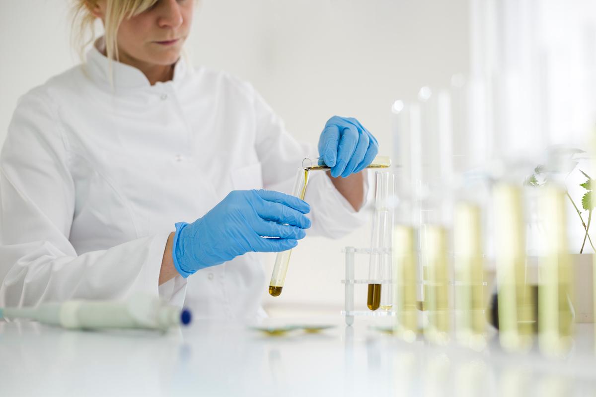 Woman extracting CBD oil