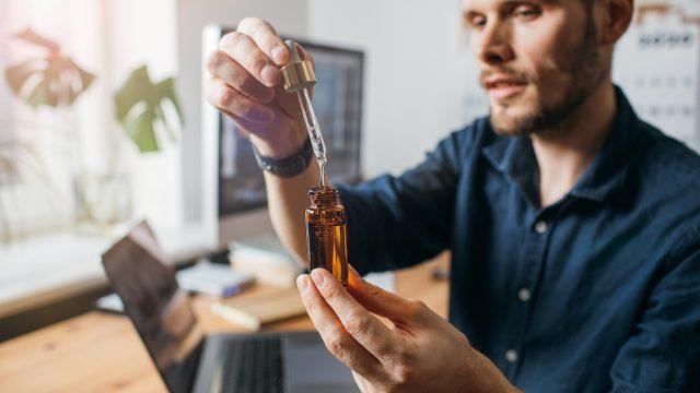 Man taking CBD oil
