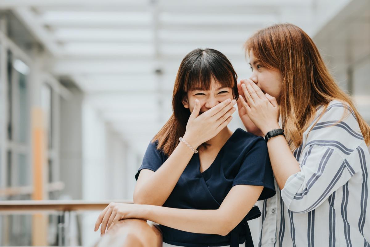 Young Asian women laughing at a joke